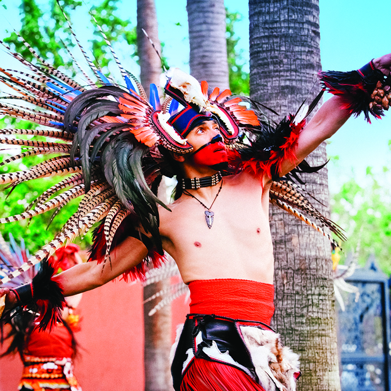 Aztec dancer performs in an Aztec ceremonial dance at the Mexican Herritage Plaza