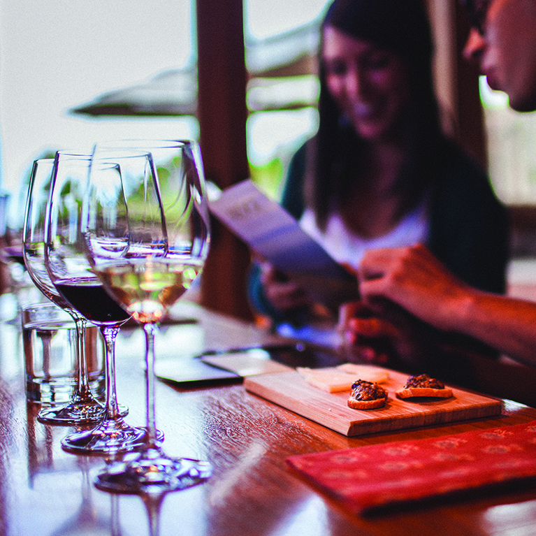 A couple enjoying wine and cheese pairings in the private tasting room at Ridge Winery
