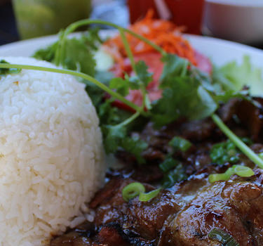 A vietnamese beef dish with rice and pickled vegetable salad at Vietnam Town restaurant.