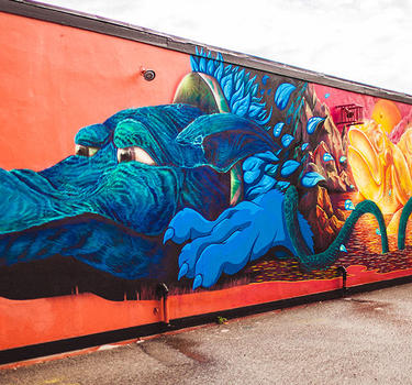 "A beautiful mural title ""Little Moment"", Some say it's a wolf, a dog and even a dragon!"