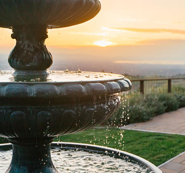 A fountain with a gorgeous sunset background on Mount Hamilton