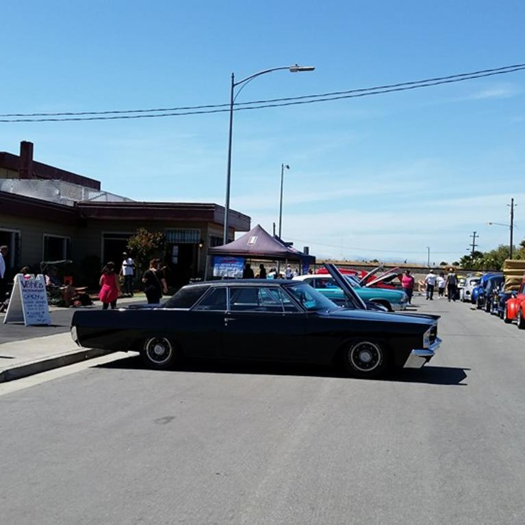 Exterior of Vahls with a classic car